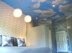 """""""Samantha's Cloud Room,"""" one of the themed suites at The Roxbury Motel in the Catskills. This particular room is based on the TV show Bewitched, specifically the scenes where Samantha would meet with her mother or another character up in the clouds."""