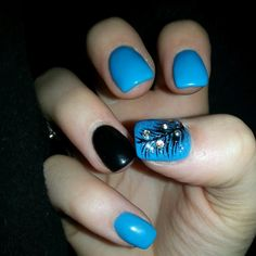 Blue nails with black feather