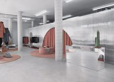 RETAIL: Bower designs The Arrivals' concept-stores - Huskdesignblog | Bower studio nyc | The Arrivals | retail | store | store nyc | fashion store | ready-to-wear store | metal architecture | metal interior design | rust color | pink color | fabric pouf | rounded rug | brand new store | american designers | american store | neon lighting | white walls | commercial architecture | branding store | prêt-à-porter | fashion brand | outerwear collection | clothing rack | arch | burgundy