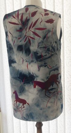 """Ref: 16 long £75.00 Denim distressed blue embroidered hand painted red horses fauna Please check measurements against a garment you wear. To nearest half-inch: Back neck to hem 29.5"""", Back underarm to underarm 20"""", Side underarm to hem 19.5"""" Each front panel side seam to front opening 10"""", Armhole circumference 22.5"""" further information contact Jackie Wills www.jackiewills.com"""