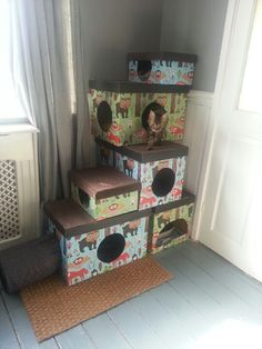 Cat tree made from cardboard boxes.