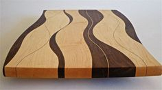 The description below is from the site. I Love the pattern in this one. Now I just need to stock up on wood.  :Cutting Board Wood Kitchen Serving Board Chopping Block Serving Platter $125