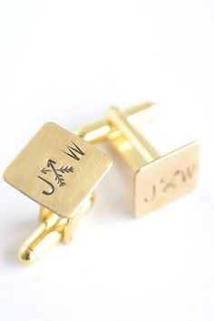 Yellow gold cuflinks with  monogram and arrows