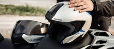 BMW Motorrad's all new System 7 Carbon 2-in-1 full face and jet version Helmet! Find out more: http://www.ministryofbikes.co.uk/blog/bmws-new-system-7-carbon-helmet