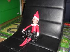 Elf on the Shelf playing playstation