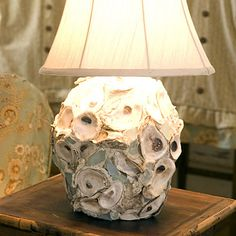 Oyster Shell Lamp. Gotta make this for the guest bedroom.