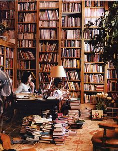 Nigella Lawson in her well stocked library.