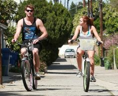 Miley Cyrus And Liam Hemsworth Riding Their Bikes In Toluca Lake - aww their so cute together!