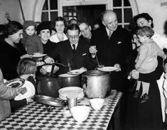 Sussex, England -- Lord Woolton, British Minister of Food, serves up food to young diners at a mobile field kitchen Lord Woolton is buried in my local churchyard in Walberton. Vegetarian Pie, Savoy Hotel, British Home, The Blitz, House Of Commons, Soup Kitchen, British People, British Government, Women In History