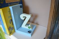 Letter and Shape Book Ends - Dancing Duck Designs Dancing Duck, Shape Books, Bookends, Colours, Shapes, Lettering, Design, Home Decor, Homemade Home Decor