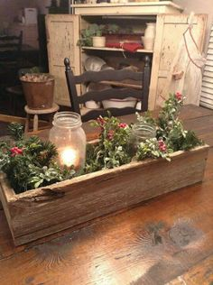 A wooden box, a canning jar, a candle and greens cut from the yard make a lovely old time Christmas centerpiece.