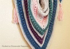 Spring is almost here! Can you feel it? I definitely can here in Arizona. I was inspired by our gorgeous weather and pretty pastels to make this Spring Shawl Crochet Pattern.