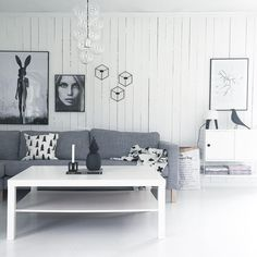 Living room with Charles Eames housebird, menu pov candleholder wall, paperbag for flowers and so on. Grey, white and black tones.