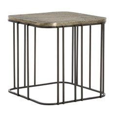 We love that this design alludes to volume without actually feeling heavy in a room. The height makes it perfect next to armless upholstery or in front of a sofa or settee. The elegantly-carved top, clad in brass and finished in antique silver, has a pattern that loosely resembles finger prints. The base is made of natural iron. A graphic element in any room.  Material: Iron, Brass Sheet Finish: Vintage Silver