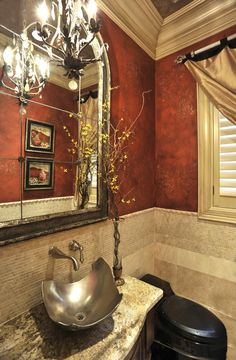 Powder room (love the tan'ish crown molding, love the color on the wall, and love the tile work.)