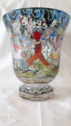 A fullcolour enameled vase with dancing children, signed Ciriama in gold. Probably Alsace 1900. School of Nancy. Height 22 cm, diameter 19 cm.