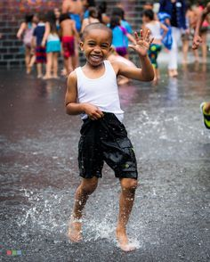 :  The sweet smile of a child. . Chicago's Crown Fountain 2/3. .  Jul 2015. 1/500 sec @ f/5.6 ISO 400. Canon EOS 6D with Canon EF 70-300mm f/4-5.6 L IS USM II. . #adventurevisuals #igworldclub #welivetoexplore #special_shots #xploration_nation #outside_project #ig_captures #ig_impulse #artofvisuals #gramoftheday#jj_community #sharecg #myflagrants #ig_impulse #insta_chicago @explorechicago #ChicagoIG #rsa_urban #ig_northamerica_bw #jj_chicagoland #streetphotographer #street_oftheworld…