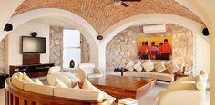 Domed brick ceiling and natural stone walls.