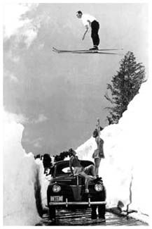 Even six decades ago, men would do just about anything to impress the ladies! This poster features an early example of an extreme daredevil skier, soaring high above a cleared mountain road, to show off to two lovely lasses in sun dresses and snow boots tanning on their car below. Taken on volcanic Mt. Lassen in Northern California in 1942.