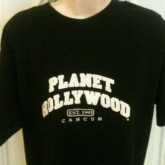 Planet Hollywood Cancun Large T-Shirt. Planet Hollywood Cancun black large t-shirt. Cant just go to the mall 2 get this! i had 2 go to Cancun, Mexico. Now, I have never worn it or washed it, but somehow, there are mystery bleach stains on back. Shown in pic, hence the price. planet hollywood Tops Tees - Short Sleeve