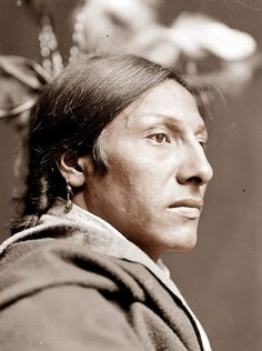 portrait of Amos Two Bulls, a Sioux Brave. The picture was taken in 1900. By this time, the traditional Indian lifestyle had pretty much come to an end. Most were living on reservations at this point. Amos Two Bulls was a member of the Buffalo Bill Wild West Show.