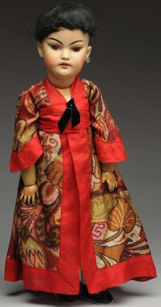 """S & H Oriental Bisque Character Doll.  German socket head incised """"S & H 1129 DEP 10"""" with Oriental tinted bisque 21"""" tall"""