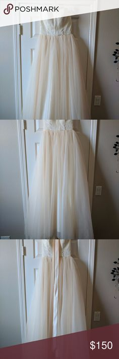Beautiful Ivory/Blush Wedding Dress NEVER WORN - This beautiful dress has an ivory lace bodice and blush tulle skirt. It's been altered and fits a size 0 (32 B/C cup). The bodice has a sweetheart, strapless neckline. Also comes with a satin blush ribbon for the waist. Dresses Wedding