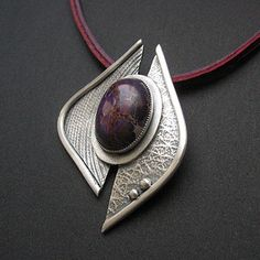 Silver clay pendant with amethyst cabochon