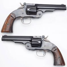 Smith & Wesson Second Model Schofield Single Action Revolver - The Schofield was designed and built to compete with the Colt Single Action Army.  It was originally chambered in .44 S&W American, and then in .45 Schofield. Its break action design allowed for fast reloads, but incompatability with the .45 Long Colt catridge limited its popularity.