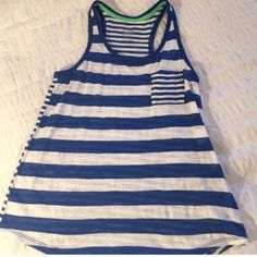 ⭐️Justice racerback tank top Royal blue and white stripes. The pockets do the back  has thinner stripes. Great condition Size kids 14 but would fit women's XS. No stains, rips,etc. Justice Tops Tank Tops