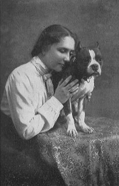 Helen Keller with her pit bull, Maggie.- I truely love this because here there are people who see pitbulls and think they are such vicious animals. Helen Keller was blind and death, she had no judgment, she loved the dog no matter what breed it was. sometimes i wish people its not the breed thats cruel, its themselves.