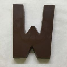 The letter W made of milk chocolate.