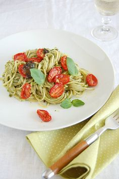 Spaghetti with pistachio pesto and roasted cherry tomatoes