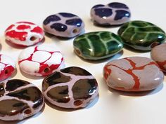 Kazuri Pita Pat Animal Pattern Beads, 12 pieces - Fair Trade Bead, Matched Pairs, Ceramic, Kazuri Beads, Animal Pattern Beads, Earring Pairs by offthebeadingpathva on Etsy