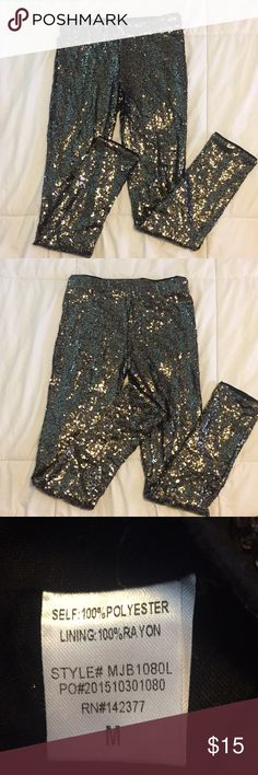 May & July Sequin Leggings Size medium May & July Brand black leggings with gold sequins. These leggings have been worn once. They do not fit tight at the ankles. May & July Pants Leggings