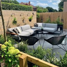 A great way to incorporate seating into a garden without it taking up a lot of space is to make it part of a fence or wall. You could build a simple wooden bench or a more substantial banquette seating. Perfect for cosying up in the summer evenings! #patiolife #patioseating #gardenseating #patio Outside Seating Area, Deck Seating, Backyard Seating, Outdoor Seating Areas, Garden Seating, Outdoor Lounge, Outdoor Living, Outdoor Decor, Outdoor Decking