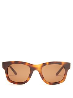 Sun Buddies's Bibi sunglasses are inspired by the styles worn in Ingmar Bergman's 1966 film, Persona. This tonal-brown and orange tortoiseshell Bibi pair is crafted from glossy Italian acetate to a classic D-frame shape, and devoid of any branding for a superlatively sleek feel. The brown-tinted lenses are made by Zeiss, and offer 100% UV protection.