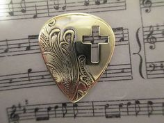 Vintage Silver and Brass Cross Guitar Pick.  Click on the picture to buy!