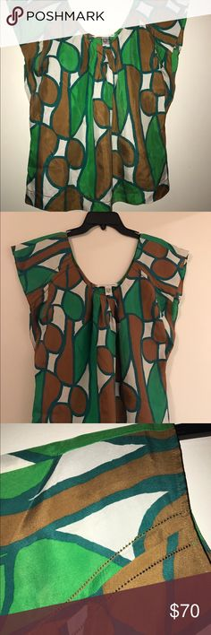 Diane Von Furstenberg silk top Beautiful silk Diana von Furstenberg top. Purchased from Nordstrom four years ago.  I have worn maybe twice.  Just not my style. Will be freshly dry cleaned prior to shipping. Diane von Furstenberg Tops Blouses