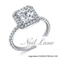 Princess Cut Diamond Engagement Rings    2-carat princess-cut diamond ring set in platinum and surrounded with 70 diamonds by Neil Lane. (Neil Lane: neillanejewelry.com)  Details    cut: Princess   jewelry for: her   Jewelry Type: engagement rings   metal: Platinum   Wedding Style: glamorous