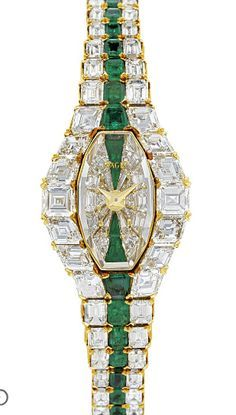 PIAGET. A LADY'S MAGNIFICENT AND RARE 18K GOLD, DIAMOND AND EMERALD-SET BRACELET WATCH SIGNED PIAGET, AURA MODEL, CASE NO. 13011 & 504'717, MANUFACTURED IN 1989 Mechanical jewelled lever movement, calibré-cut diamond and trapeze-cut emerald-set dial, tonneau-shaped case with calibré-cut diamond and emerald-set bezel, back secured by two screws, back winder, 18k gold Piaget bracelet set with baguette-cut diamonds and a central row of baguette-cut emeralds, case, crystal and movement signed