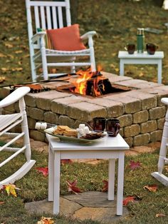 DIY square firepit with bricks pavers and stepping stones for tables and chairs to level you out.