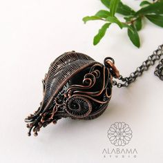Black inside  unique 3-dimensional copper pendant by AlabamaStudio  It can be a symbol of everything which is hidden inside our soul or a sign of new beginning - the bud is going to blossom :)