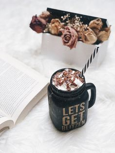 Coffee, book and flowers.