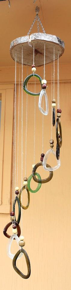 Gorgeous spiral #windchime made from #slumped wine bottle rings!  Great way to #upcycle!  #pournomore