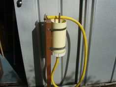 HOME BREW BEER BOTTLE WASHER |   Tyre valve used. Bottle weight opens valve when pushed down. Connected to a garden hose.
