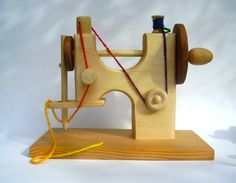 Wooden Toy Sewing Machine...This is perfect! Will keep the kids from wanting to play with mine!