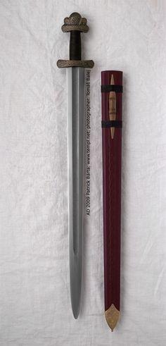 Full view with scabbard. Viking sword hilt from cooper inlay iron, pattern-welded blade. 8th Century. Gjermundbu, Norway.