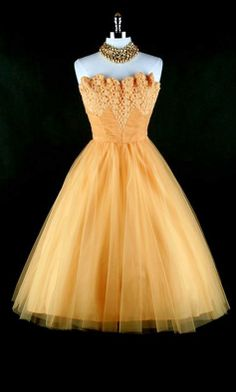 1950's Cocktail dress. Marigold yellow till with lace trim* Scallop edge bodice* Strapless boned bust* Metal side zipper* Acetate lining.