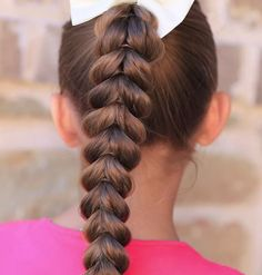Work the Updo! 9 Pretty Ponytail Ideas For Girls: On the days that you leave your daughter's hair down, odds are she will return from school with at least one unidentified substance stuck on the ends and encrusted in various strands.